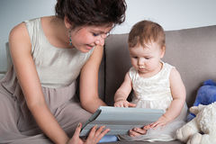 Mom is playing with her adorable child Royalty Free Stock Images