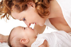 Mom playing with her cute baby girl royalty free stock images