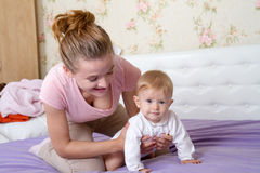 Mom playing with a little girl, baby Royalty Free Stock Photos