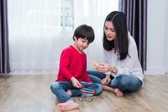 Mom playing with son in home. Teacher and her student playing to royalty free stock photos