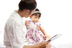 Mom is playing tablet with her baby Royalty Free Stock Photography