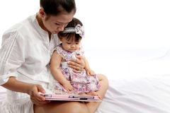 Mom is playing tablet with her baby Stock Photos
