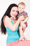 Mom playing with young son colored clothing Stock Image