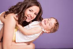 Mom playing with young son laughing joy. 1 Royalty Free Stock Images