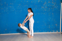 Mom playing with young son in a room. With blue walls Royalty Free Stock Image