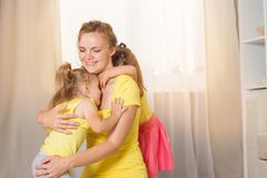 Mom plays with children twins royalty free stock photography