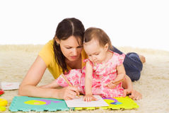 Mom plays with daughter Stock Images
