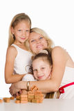 Mom plays with daughters Stock Photo