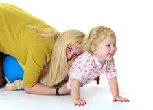 Mom plays on the floor with her little daughter Stock Photo