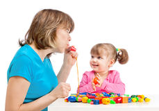 Mom plays with her daughter Stock Images