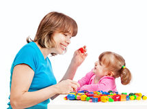 Mom plays with her daughter Stock Photos