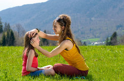 Mom plays with her daughter in a field Royalty Free Stock Photos