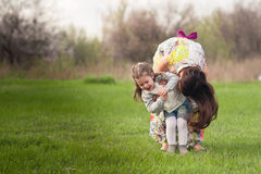 Mom plays with her daughter in the lush spring garden Stock Images