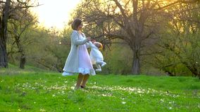Mom plays with her little daughter in the park stock video footage