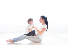 Mom plays with her son on the floor of the happiness Royalty Free Stock Image
