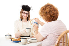 Mom Pours the Tea Royalty Free Stock Images
