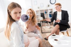 Mom with a pregnant teenage girl at a psychologist`s reception. royalty free stock images
