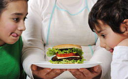 Mom prepared delicious hamburger Stock Photography