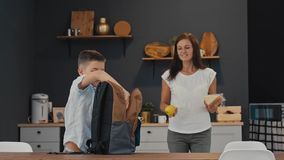 Mom prepares lunch for her son at school stock video footage