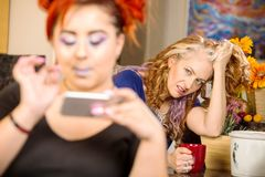 Daughter on phone angering mother royalty free stock photo
