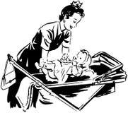 Mom Putting Baby In Pram Stock Photo