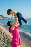 Mom raising child in the sun Royalty Free Stock Images