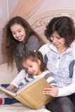 Mom reading a book with children. Royalty Free Stock Photo