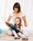 Mom reading book with her little daughter Royalty Free Stock Images