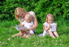 Mom reading book to daughter. Stock Image