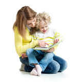 Mom reading book to kid Stock Photos