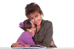 Mom reads with daughter Stock Image