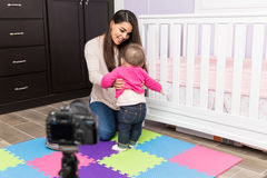 Mom recording video with her baby Stock Image
