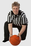 Mom Referee. Short hair blond mother type woman wearing striped referee shirt holding a basketball over white stock photo