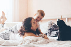 Mom relaxing with her little son Stock Photos