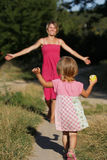 Mom runs out to meet her little daughter. On nature Stock Images