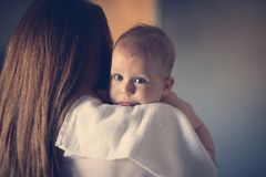 Mom's arms, the safest place on earth royalty free stock photo