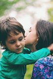 The boy is hugging his mother. Mom`s embrace. The boy is hugging his mother. Smiling women walks with her son in nature. Portrait of a women with a child. Time royalty free stock photos
