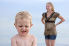 Mom scolded the boy and the boy is hurt away Royalty Free Stock Image