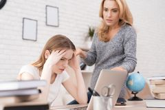 Mom scolds her daughter for a bad job on the laptop. The daughter can not do the school assignment correctly. The women is angry because of this. She screams Royalty Free Stock Image