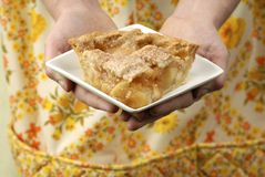 Mom serving apple pie Stock Images