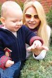 Mom shows son ladybird Stock Photo