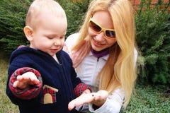 Mom shows son ladybird Stock Image