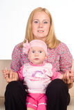 Mom sits with baby Stock Photos