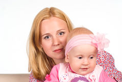 Mom sits with her baby Stock Image