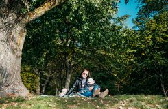 Mom with a small child resting in the Park in the fall royalty free stock images