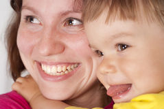 Mom smiles with daughter Royalty Free Stock Photos