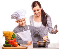 Mom and som are cooking in the kitchen Stock Image