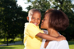 Mom and son. A happy african american mom poses with her son