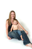Mom and Son. A mother lets her son sit in her lap. A baby seeking protection in his mothers arms. A boy being protective over his mother Royalty Free Stock Photo