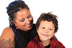 Mom and son. Single mother looks lovingly at her multiracial son on a white background royalty free stock photography